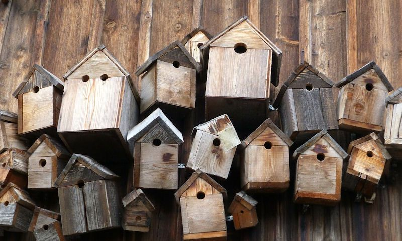 Pile of old, dark stained bird boxes