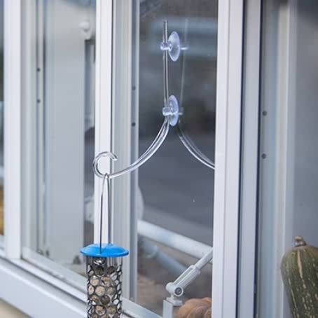 Clear window bracket with hanging nut feeder