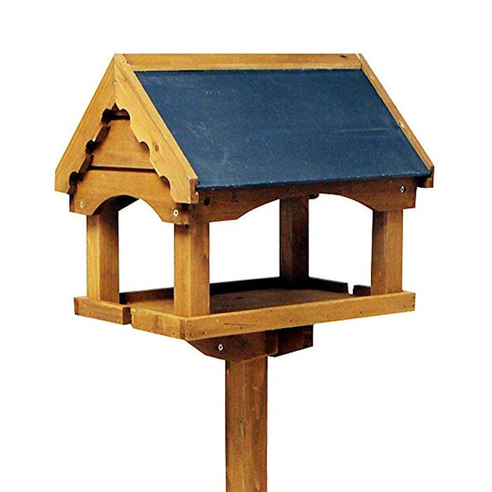 Wooden bird table with high eaves